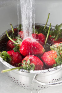cleaning strawberries