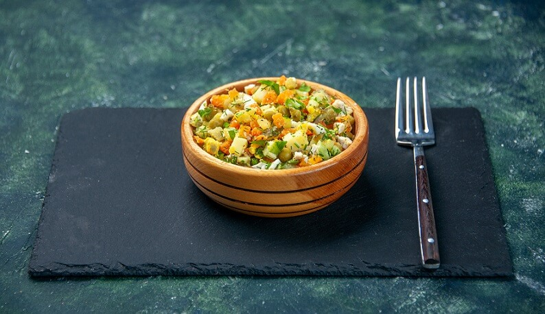 serving vegetables in bowl on table